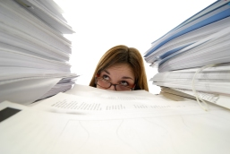 Woman-buried-in-paper-Bigstock.jpg